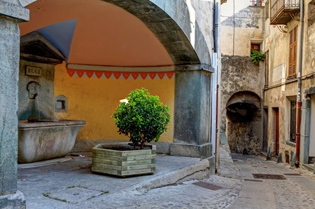 Tende, France. Village in Sothern France. Old street and drinkiing fountain.