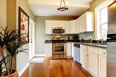 stove: Beautiful white kitchen with cherry floor
