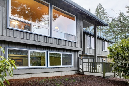 windows: Simple American split level house exterior.