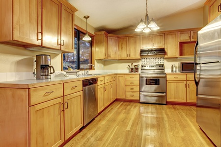 Nice American kitchen with yellow wood  photo