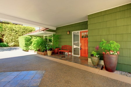 Summer sunny day house exterior of the long green hosue with beautiful curb appeal. photo