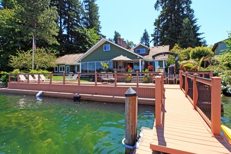 Beautiful lake waterfront property with dock and large deck. photo