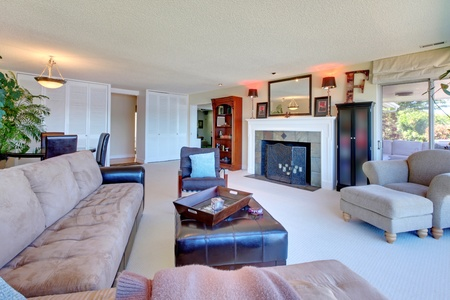 family living: Large living room with fireplace and large brown sofa.