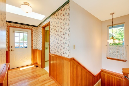 Sunny hallway with warm wood, wallpaper and front door and window. Stock Photo - 12621249