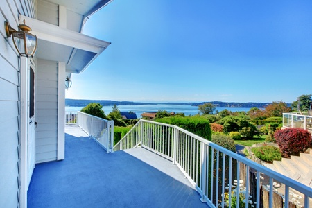 House exterior grey large porch with water view. Stock Photo - 12621294