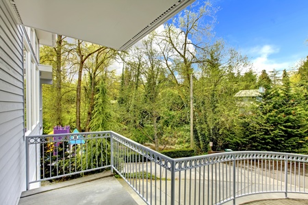 House with balcony railing and view of the driveway. Stock Photo - 12621337