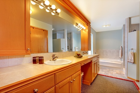 double sink: Nice large bathroom with simple classic design.