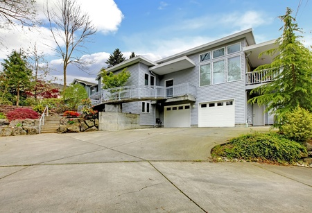 Grey modern home exterior with large parking space. Stock Photo - 12621327