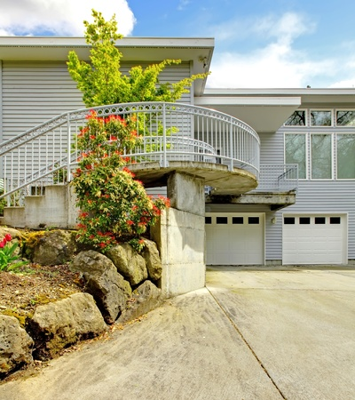 Large grey house exterior of modern home with large parking lot. Stock Photo - 12621262