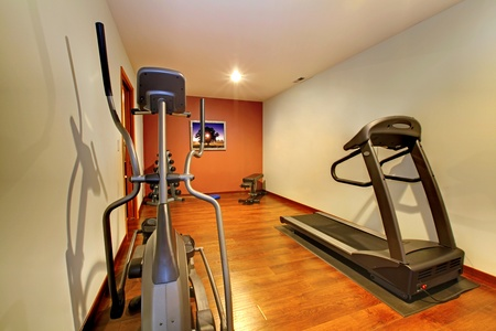 basement: Nice home gym with sport equipment. Stock Photo