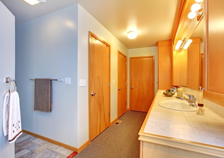 Bathroom with many doors to closets interior. photo