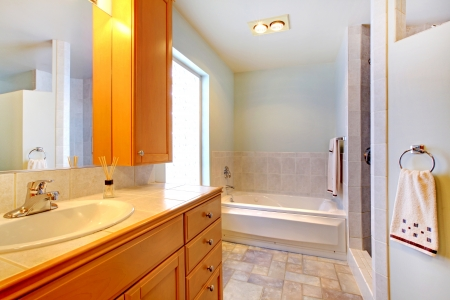 Nice large bathroom with simple classic design.