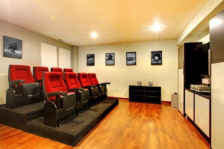 family movies: Home TV movie theater entertainment room interior with real cinema chairs.