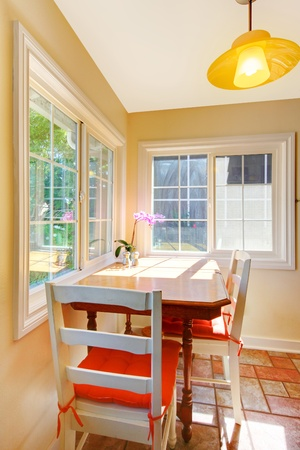 Cozy dining table breakfast area in the small kitchen. Stock Photo - 12621437