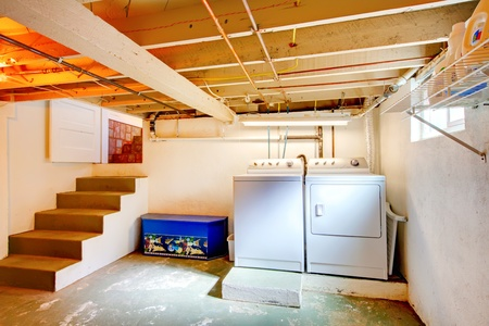 basement: Old basement laundry room with old appliances. Stock Photo