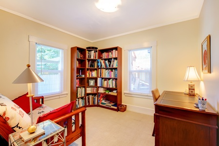 Mice bright reading room with books and desk. Stock Photo - 12621428