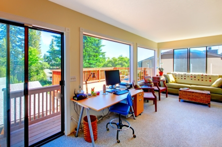 home office desk: Home office and living room with balcomy view inteior.