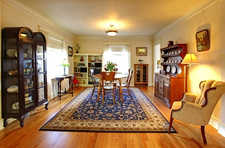 Old country English charm living and dining room with blue rug. photo