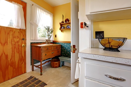 Old English kitchen with two doors and counter. Yellow and green. photo