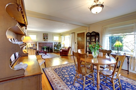 wood molding: Old country English charm living and dining room with blue rug. Stock Photo