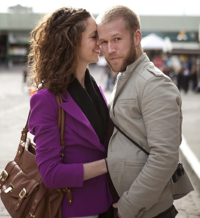 Beautiful couple on the street hugging and smiling. photo