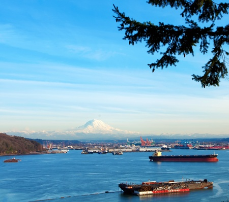 shipping port: Tacoma port with cargo ships and Volcano Mt. Ranier. during sunny winter day.