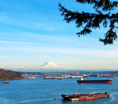 tacoma: Tacoma port with cargo ships and Volcano Mt. Ranier. during sunny winter day.