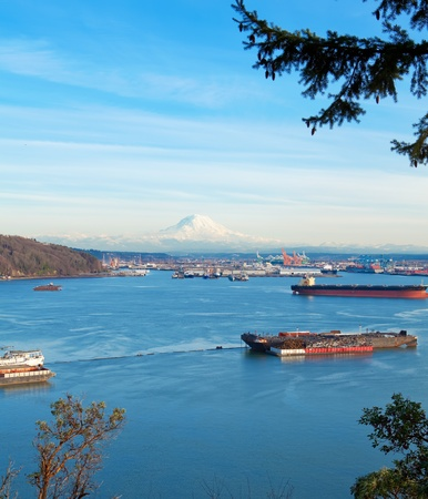 tacoma: Tacoma port with cargo ships and Volcano Mt. Ranier. during sunny winter day.