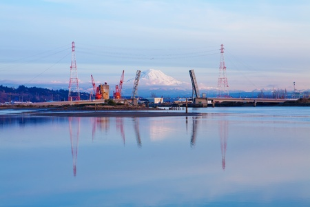 tacoma: Mt.Ranier and Tacoma port with cranes and open double bridge.