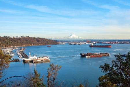 Tacoma port with marina, cargo ships and volcano Mt. Ranier. photo