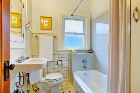 White bathroom with tiles and tub. Stock Photo - 12760825