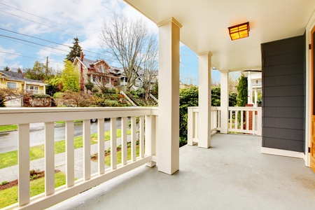 Covered white porch house exteruor with spring street view. Stock Photo - 12760948
