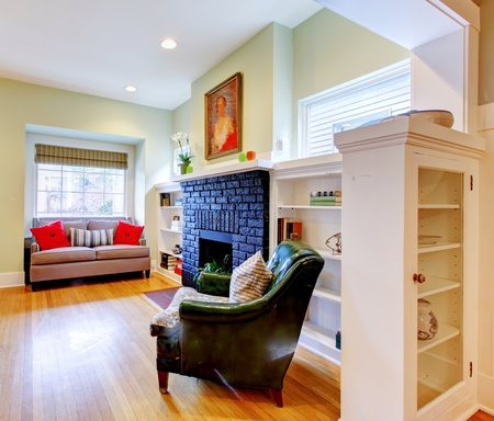 classic living room: Small old house classic living room interior with black fireplace. Stock Photo