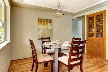 Dining room table with plates in a beautiful small room. photo