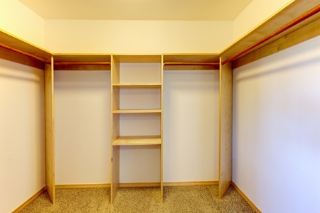 New empty closet room with build-in shelves. Stock Photo - 12760872