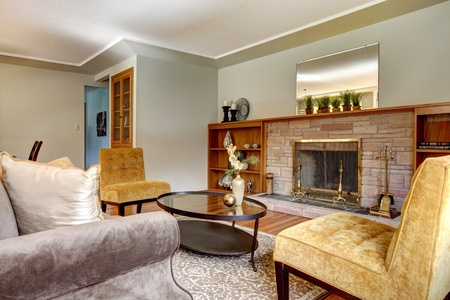 Elegant seventies lving room with fireplace. photo