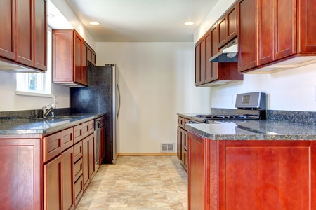 Simple dark cherry kitchen with stainless steal appliances. Stock Photo - 12760889