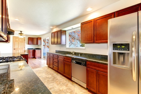 Large bright kitchen with dark cherry cabinets and stainless steal appliances.  Stock Photo - 12760893