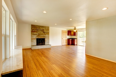 fireplace family: Large new empty living room with hardwood floor.