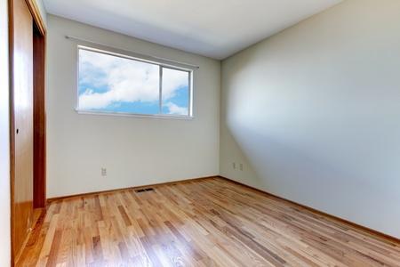 Clean new empty room interior with shiny hardwood floor. Stock Photo - 12760823