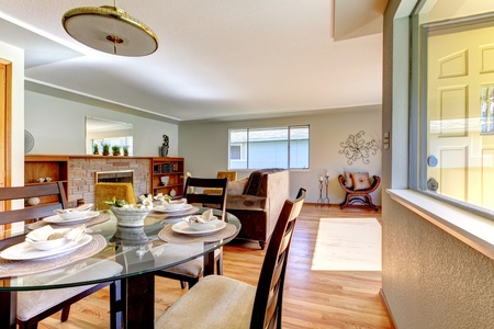 Dining and living room house interior with wood fence. Stock Photo - 12760885