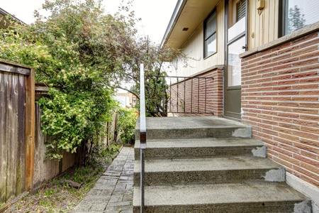 Simple brick rambler house exterior side. Stock Photo - 12760965