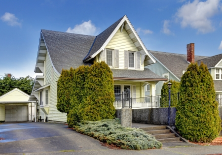 outside outdoor outdoors exterior: Craftsman style yelow cute American house exterior.
