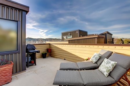 Apartment building roof top terrace exterior with modern living area. photo