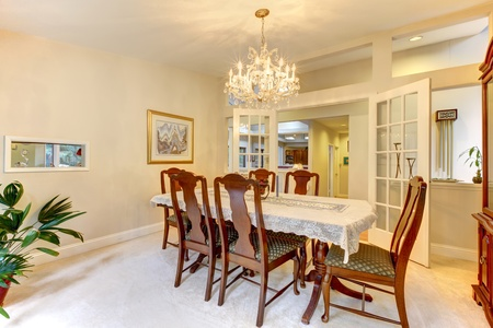Clasic American dining room interior with open french doors. photo