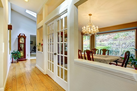french doors: Hall way and dining room interior. Stock Photo