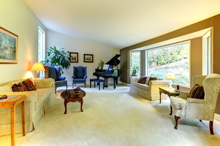 Living room with large window and piano.