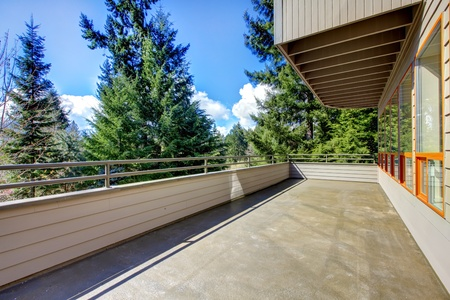 Large house balcony with woods view. Stock Photo - 13122570