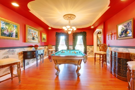 living room sofa: Red billiard luxury room with play pool and cherry hardwood. Stock Photo