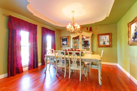 Large luxury green dining room with cherry hardwood.
